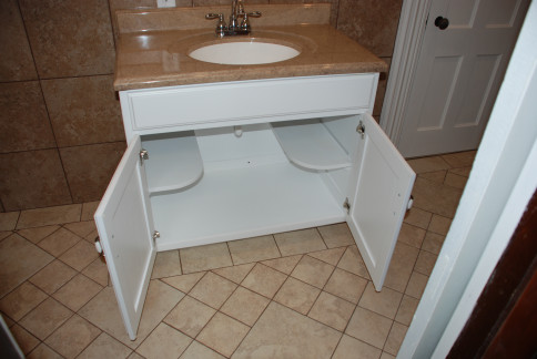 Drawers Aren T Really Needed In A Commercial Bath So Shelves Were Incorporated To Hold Cleaning Supplies And Paper Goods